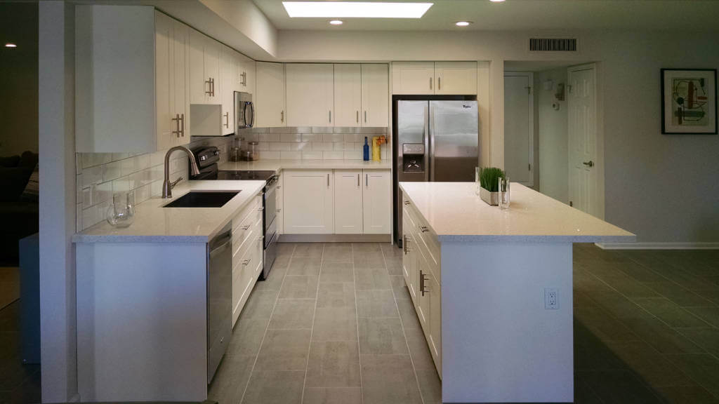 Scottsdale kitchen remodel- white shaker cabinets, gray tile floor, quartz countertop, subway tile & stainless steel appliances