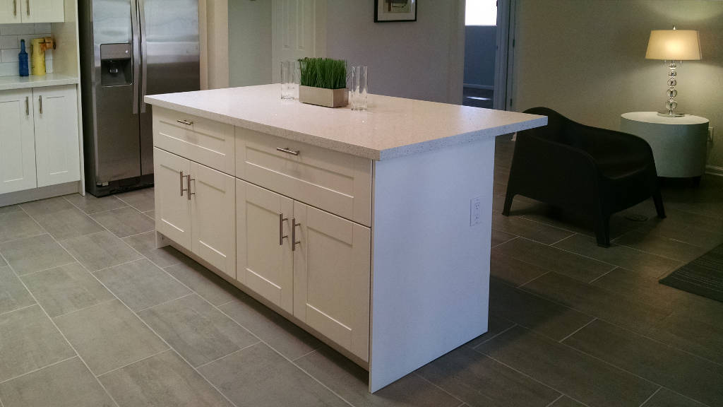 Six foot kitchen island with large drawers and white quartz countertop