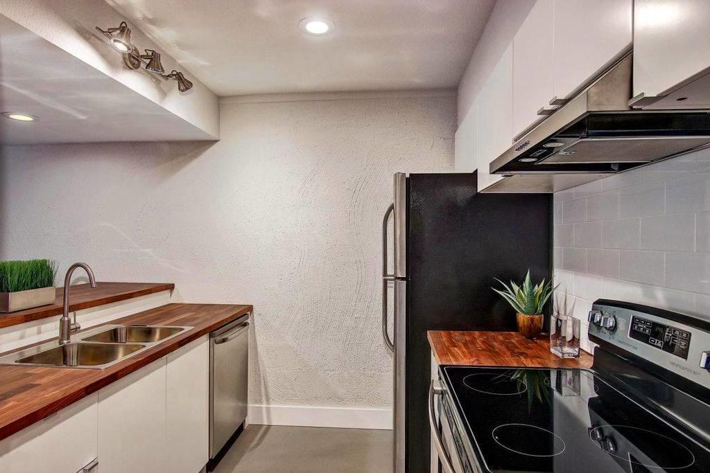 Modern Scottsdale kitchen with walnut countertops