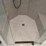 Custom corner shower with large corner benches