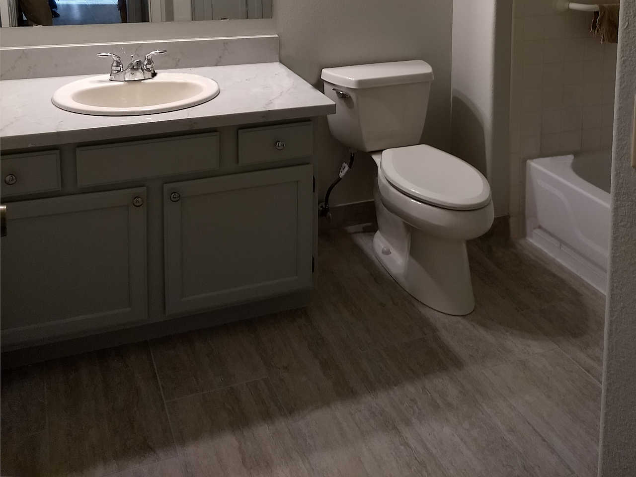 gray-12x24-tile-gray-vanity-quartz-countertop-1.1