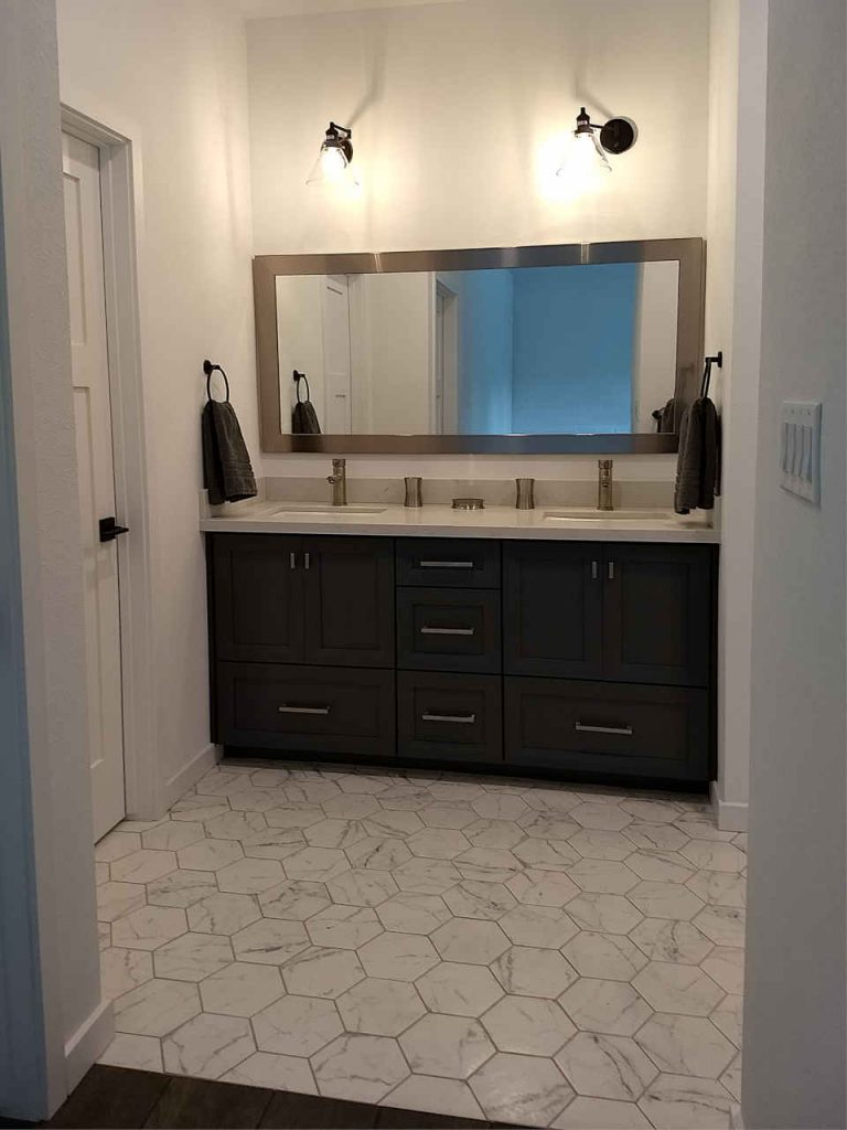 Custom double vanity- dark gray, full length mirror, coach lights, tile floor