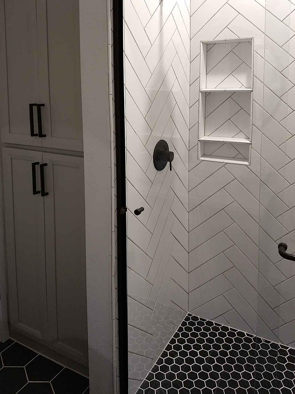 shower-white-herringbone-tile-2.0