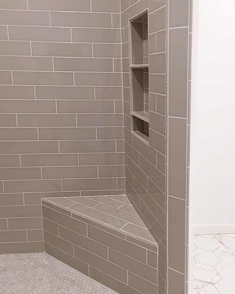 subway-tile-shower-corner-bench-and-niche