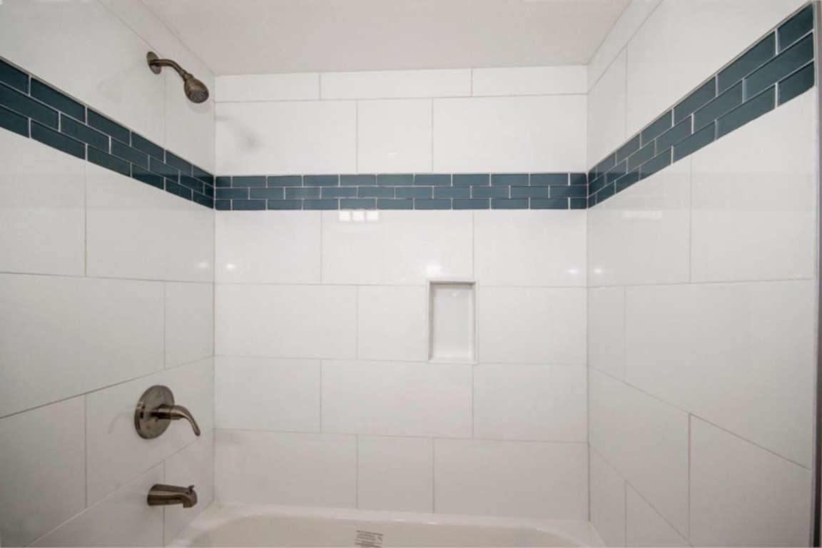 white-shower-tile-blue-deco-band-CC