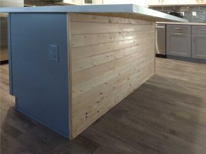 kitchen island with wood front trim in scottsdale