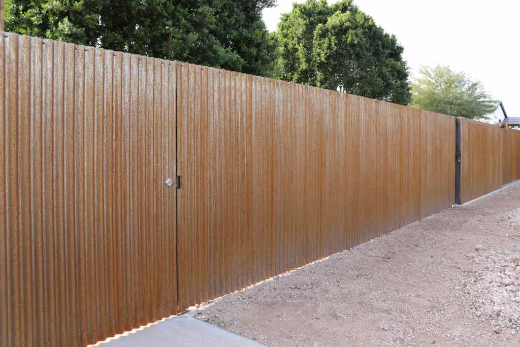 corrugated rustey steel fence installer scottsdale