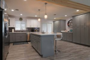 kitchen with gray white cabinets and wood beam