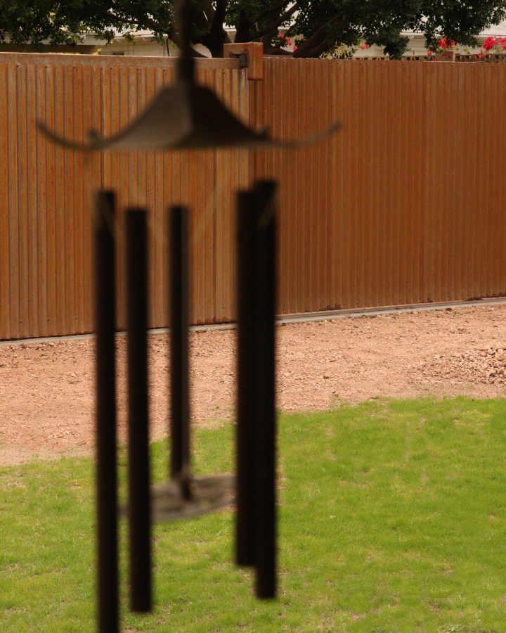 Rusty steel fence with rolling gate in Phoenix AZ